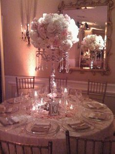 Love this centerpiece.. doing something like this for a few of the tables. without the hangy jewels of course :)