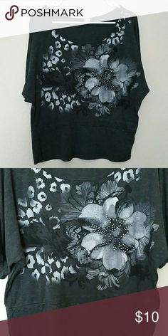 Short sleeve shirt w/jewel embellished flower Dark gray shirt, cotton material, stretchy. Size XL. Has a jewel embellished flower and a cheetah like print. Perfect condition. Agenda Tops Tees - Short Sleeve