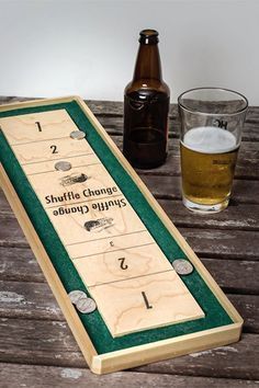 Tabletop shuffle board with coins. Love it. 19 Essentials For The Ultimate Home Bar #refinery29