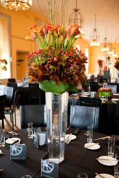 Planet Flowers: Large clear vase with red orange and green flower centrepiece