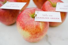 Bright Gala apples are an autumn staple, so consider utilizing them as a decorative wedding element. Top each fruit with an escort card in a complimentary hue or place an apple atop all place settings, affixed with a name tag.