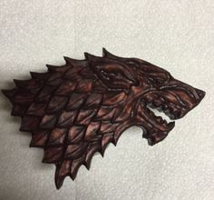 Designed it in Vcarve and then cut on my CNC.  GoT Stark Wolfs Head carved from pine and stained with a dark gel stain