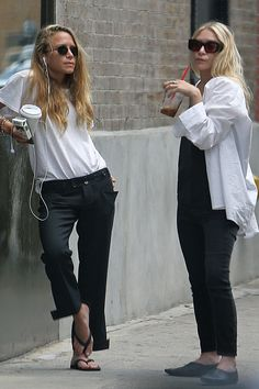 Mary-Kate Olsen in a slouchy tee and trouser ensemble, retro round shades, an armful of beaded bracelets, and flip-flops. Ashley Olsen in an oversize oxford shirt and Moroccan-inspired point-toe babouches.