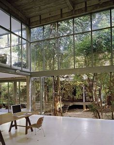the one thing artist rirkrit tiravanija, said to his former student, architect aroon puritat, when building his new home,'don't knock down trees'. so this beaut