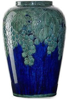 pottery & porcelain, Louisiana, A Newcomb College [pottery] vase by Harriet Joor (1875 to 1965), fine, large, and early vase with grape clus...
