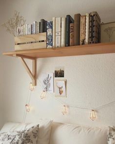 Book shelf above the bed with lights stringing down LOVE IT #bohemian #homedecor
