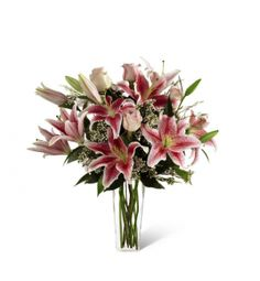 The Better Homes and Gardens™ Simple Perfection. FTD® presents the Better Homes & Gardens Simple Perfection™ Bouquet. Speak from your heart to theirs with a collection of pink vibrant blooms. Pale pink roses collaborate with the magic of Stargazer Lilies displaying their fragrant fuchsia petals amidst waxflower accents. Beautifully arranged in a clear square tapered glass vase, this bouquet sends your warmest sentiments with glamour and grace.