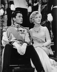 """With costar Jeremy Spenser in a production still from """"The Prince and the Showgirl"""", 1957"""