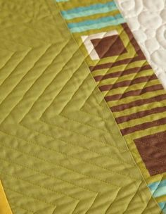 Natalia Bonner machine-quilted loops and circles across the center of the quilt top and stitched parallel chevron shapes in the middle and outer borders.