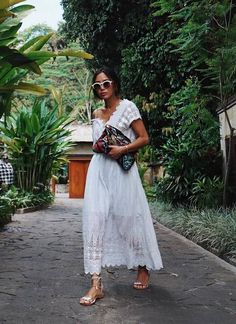 aimee song- bohemian summer outfit inspiration | bright white lace dress with cat eye sunnies and embroidered clutch | boho street style inspiration
