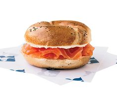 A twist on the #NewYork #bagel: Russ & Daughters layers Scottish smoked salmon, cream cheese, and red onion on a poppy-seed bagel. #EatLikeALocal