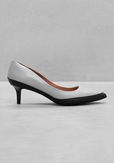 & OTHER STORIES The lady-like kitten heel style is spiced up with a modern silhouette and a refreshing colour blocking in these chic pumps crafted from buttery leather.