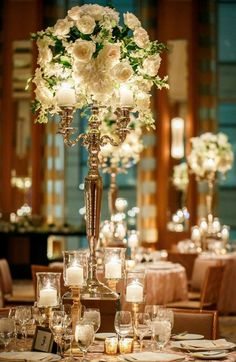 Silver candelabra white rose centerpiece http://vasemarket.com/candle-holders/candelabra-candle-holder?color=49