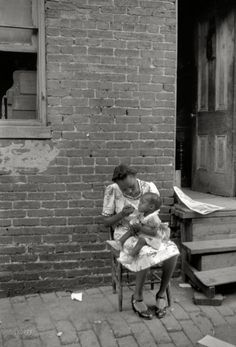 """July 1941. """"Mother and child. Alley dwelling area. Washington, D.C.""""  Photo by Edwin Rosskam"""