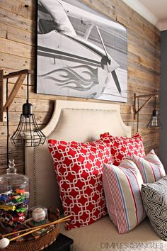 Tween boy room -- love the plank wall and industrial sconces