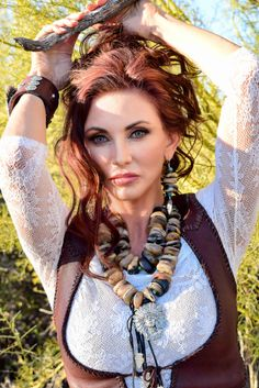 Bobbi Jeen Olson wearing Wild Instincts leather vest and Olav Jules Short Branch Collection necklace