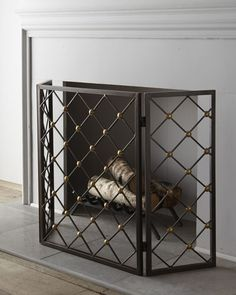 """Handcrafted fireplace screen. Made of iron with brass buttons. Outdoor safe. 52""""W x 2""""D x 31""""T. Imported. Boxed weight, approximately 29 lbs."""