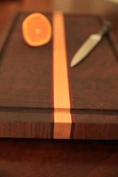 Hand-crafted, end-grain cutting board: More durable that regular cutting boards due to greater tolerance to chopping and kindness to the blade's sharpness. Materials: Walnut, maple, padauk About end-grain cutting boards: Instead of crushing against the wood's surface, the blade goes between the fibers of the cutting board, leaving less knife marks on the board and a sharper blade. Well-built and cared for cutting boards become more attractive with age, and a good cutting board, especially an…