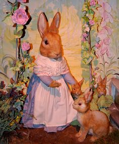 Mrs Rabbit with Flopsy, Mopsy and Cottontail at the Beatrix Potter attraction in Cumbria UK
