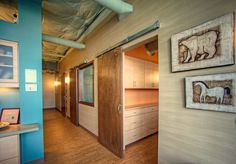 Sliding Doors. Exposed Ceiling.  Wood floors.       Piacenza Design - Chiropractic Wellness Office : Professional Spaces / Offices Interior Design