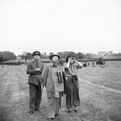 16. Winston Churchill, his daughter, Mary, and General Sir Frederick Pile (GOC Anti-Aircraft Command) watch a demonstration of measures used to combat flying bombs in the south of England on 1 july 1944