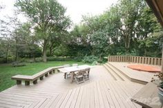 tiered deck with bench and jacuzzi