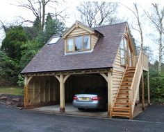 A bespoke version of our standrd 'Norton' garage, Oak external staircase, large dormer window & Velux window in tile roof.