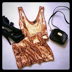 Copper sequin Rue 21 dress Fun, eye catching bodycon copper sequin dress. Size S and fits true to size.  Great going out dancing dress! Rue 21 Dresses Mini