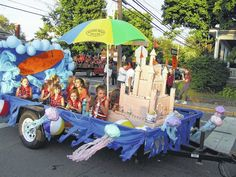 "With a theme of ""Seaside Paradise,"" the floats and parade units were appropriately bathed in sunshine Thursday evening for the annual Wilmington City Schools Homecoming Parade. Participants — and there were many — made use of sunglasses, nose sunblocks, beach towels, inflatable or handmade palm trees, Hawaiian leis, beach balls, and, well you get the [...]"