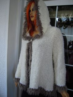 This hooded cardigan by Stella Tzortzi is a real show stopper. - 20% OFF handmade knitted hoodie sweater/ cardigan in ivory merino with faux fur/winter warm ready to ship size M,L by golden yarn https://www.facebook.com/debby.fulton/posts/830841880297407:3