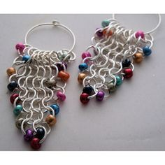 @Overstock - These timeless earrings were handcrafted using the european 1 in 4 chain maille weave. With the multiple colors in these earrings they are sure to compliment a variety of styles.http://www.overstock.com/Main-Street-Revolution/Heavenly-Beads-Multi-Color-Chain-Maille-Earrings/6727880/product.html?CID=214117 $24.99