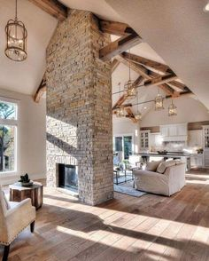 I dont know how I feel about this but i love the beams and white kitchen