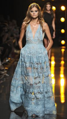 A sleeveless, baby blue lace gown with plunging neckline of Elie Saab Spring/Summer 2015 via @stylelist