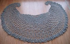 """It is a top-down, crescent/semi-circle shawl with an abundance of small flowers. The chart is only up to row 15 to give a general idea where the stitches are. Any yarn and colours will be great for it. Gauge is not important. Measurements: Top edge 62"""" x 28"""" deep Many thanks to testers: cindi120 mrmblack buzzsolo KinnicChick Note: You can sell your finished item."""
