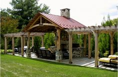 Outdoor kitchen with outdoor structure shielding bad weather.