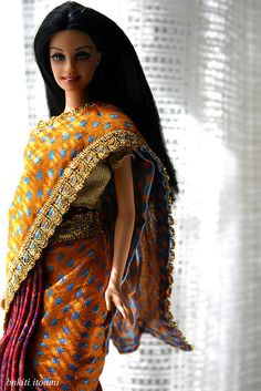 Barbie wearing orange sari