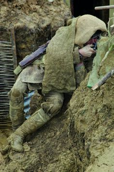 Warfare: Mr Robertshaw captured the 24-hour stint in the trench on camera for a book he wrote.