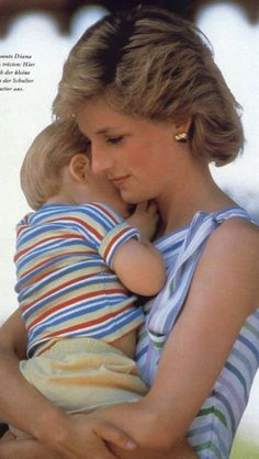 Princess Diana holding Prince Harry.