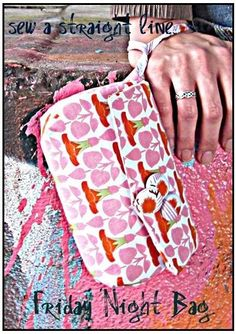 This little clutch might be sweet to make for those pastor's wives in Haiti...it's ultra girly! :-) @Debbie Arruda Huffaker  (I WANNA LEARN!!!)