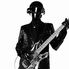 Hedi Slimane has enlisted the help of Daft Punk, looking slick in their signature helmets and black sequin tuxedos, for Saint Laurent's latest advertising campaign after working with the French musicians on the soundtrack for the AW2013 runway show and dressing them for years in Dior Homme.