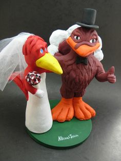 Custom made to order Hokie and Cardinal college mascot wedding cake toppers. $235 www.magicmud.com 1 800 231 9814 magicmud@magicmud... blog.magicmud.com twitter.com/... $235 #mascot #collegemascot #hokie #ms.wuf #gators #virginiatech #football mascot #wedding #toppers #custom #Groom #bride #weddingcaketoppers #caketoppers www.facebook.com/... www.tumblr.com/... instagram.com/... magicmud.com/Wedding photos.htm