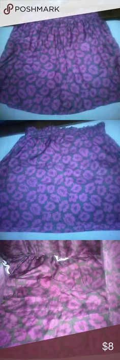 Cute skirt It's brown with pink flowers. The first picture is the front of the skirt. The second picture is the back of the skirt. The third picture is the inside. Sorry for the poor pictures. American Eagle Outfitters Skirts