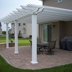 Save thousands by purchasing your Sunset Pergola Kit direct. This x Attached pergola provides shade and has a beautiful white vinyl exterior and durable aluminum frame. Vinyl Pergola, Pergola Lighting, Pergola Plans, Pergola Cost