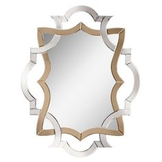 Wall mirror with an openwork Baroque-inspired frame.           Product: Wall mirror    Construction Material: Mirror...