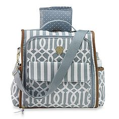 From Mud Pie comes the Bundle of Joy Diaper Bag, a super-stylish pack that converts from a backpack to a cross-body style. It has a roomy interior, and great features like a key finder and matching changing pad.
