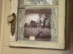 Pretty old window with old pictures and lace