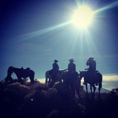 Cowboys silhouettes at Zapata Ranch, Colorado. #ZapataRanch