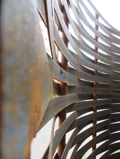 curved woven steel fence by www.steelscapes.co.uk. Once rusted the brown tones…