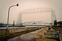 'Lift Bridge Foggy Old Photograph' by Mark David Zahn Photography (formerly Shutter Happens Photography).  Taken in March 2012 along Lake Superior, at the Lift Bridge at Canal Park, Duluth, Minnesota US.