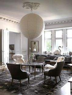 Love the overscale pendant, whimsical swan and faux fur chairs!